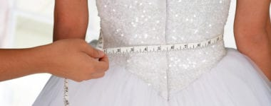 Woman in a wedding dress getting measured 380x150 - Should You Diet Before Your Wedding?